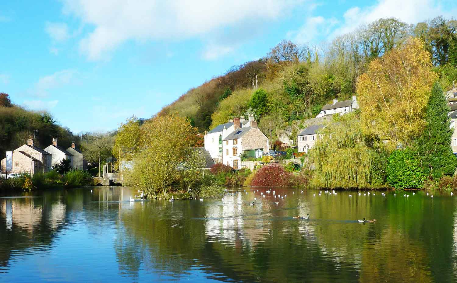 View of the picturesque Cromford Pond near Quiltessential in Derbyshire