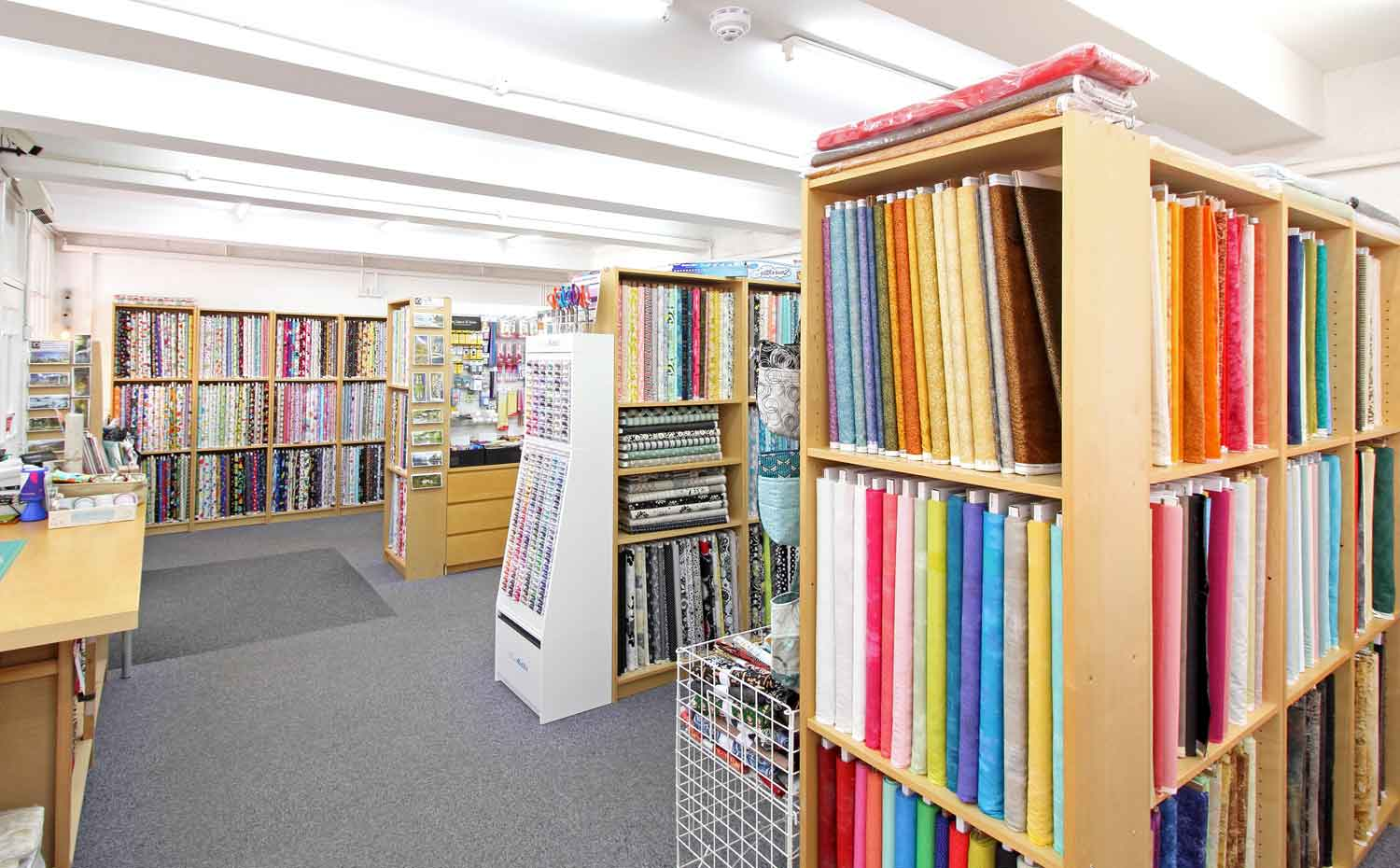 Interior view of the fabrics at Quiltessential in Cromford Derbyshire