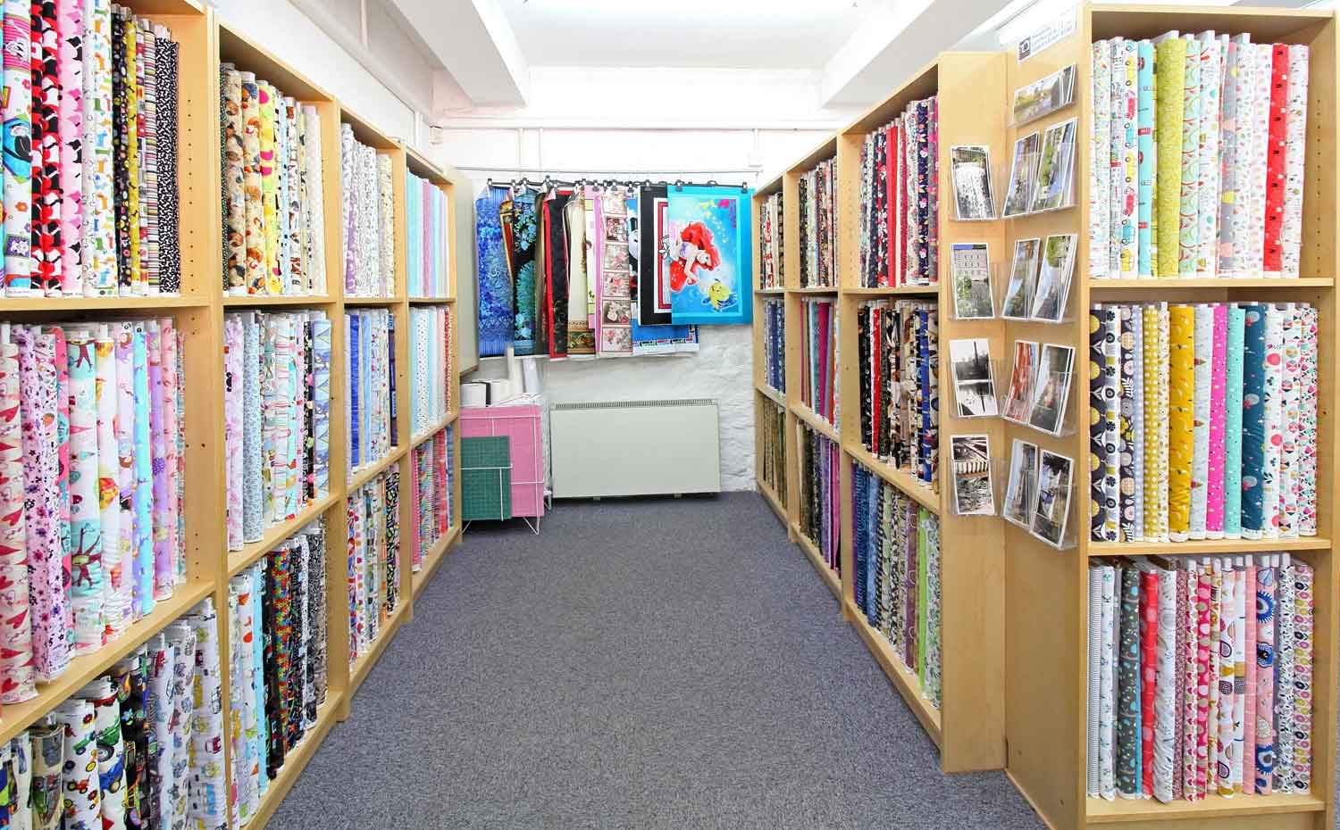 Interior view of the fabrics and panels at Quiltessential in Cromford Derbyshire