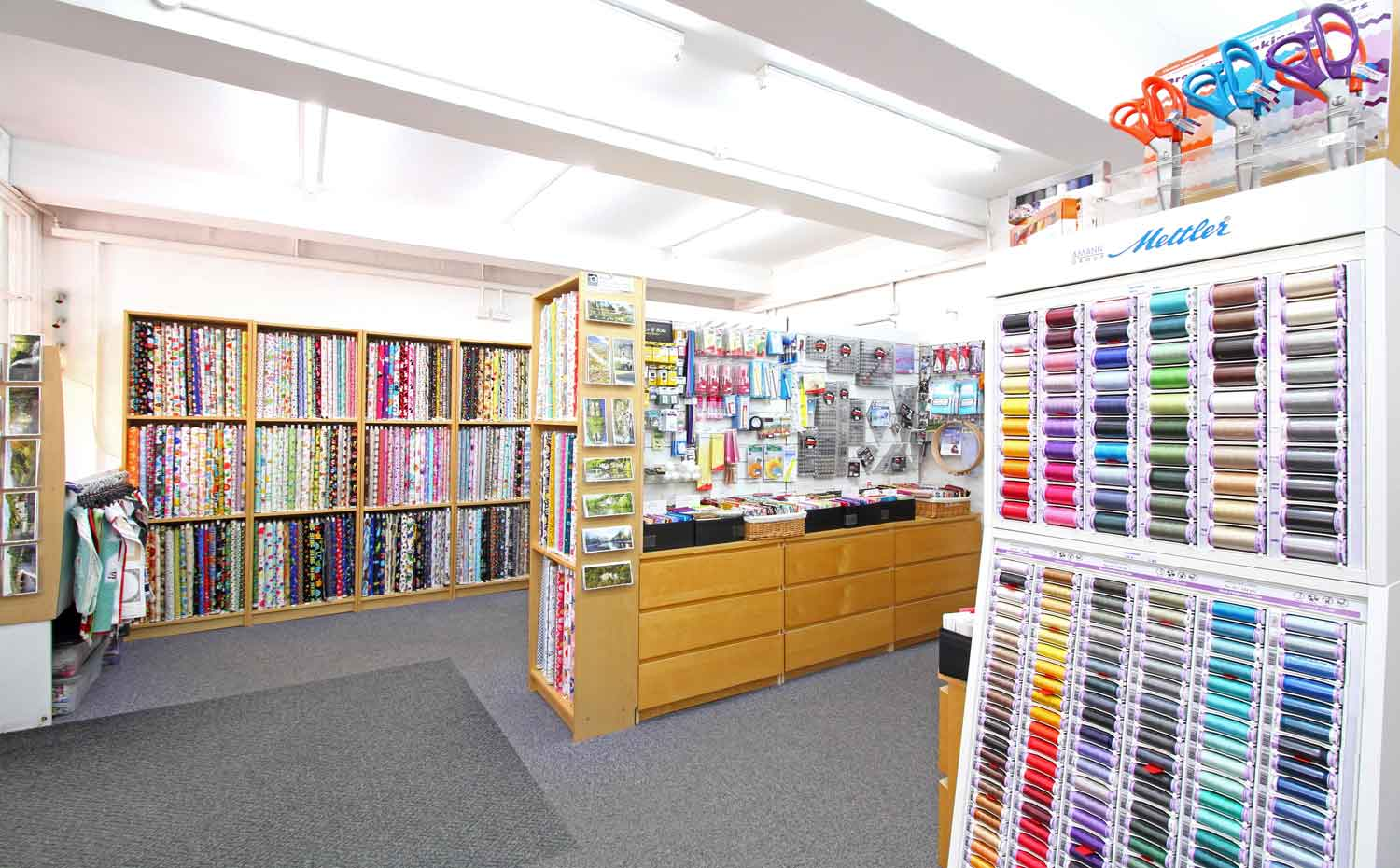 Interior view of the fabrics and sewing equipment at Quiltessential in Cromford Derbyshire